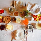 Breakfast at Miklosvar guesthouse, Transylvania. Photo: https://romanianromance.wordpress.com.
